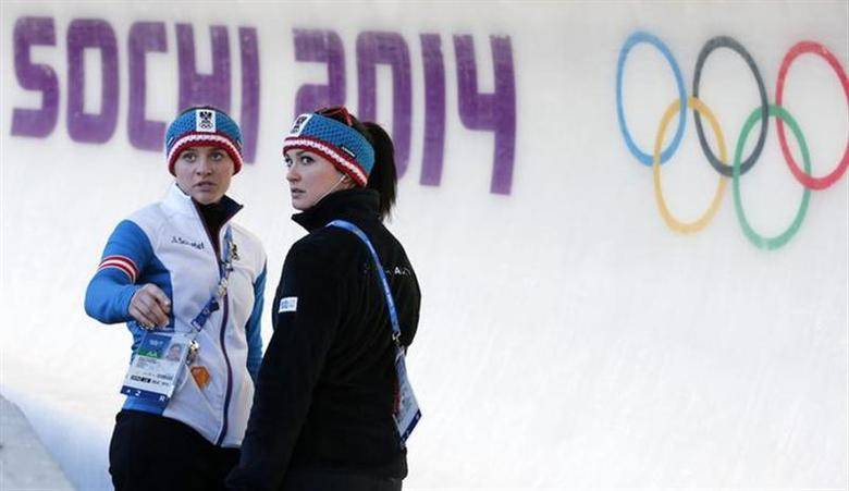 Birgit Platzer (L) and Nina Reithmayer, both of the Austrian women's luge team, inspect the track at the Sanki Sliding Center at the Sochi 2014 Winter Olympic Games February 8, 2014. REUTERS/Fabrizio Bensch