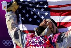 Winner Sage Kotsenburg of the U.S. celebrates after the men's snowboard slopestyle final competition at the 2014 Sochi Olympic Games in Rosa Khutor, February 8, 2014. Kotsenburg won the men's snowboarding slopestyle title at the Sochi Games on Saturday, the first gold medal of the 2014 Winter Olympics. REUTERS/Mike Blake