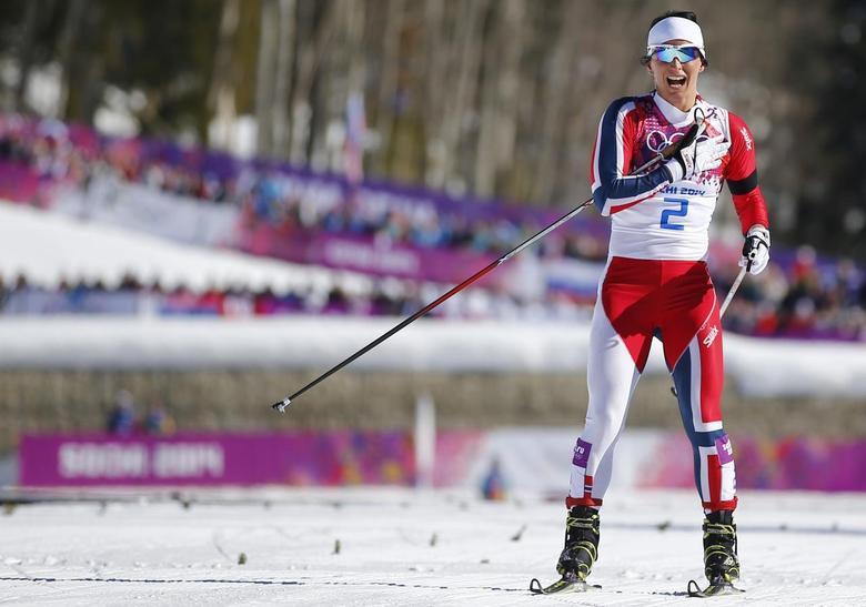 Norway's Marit Bjoergen celebrates winning the women's skiathlon event at the Sochi 2014 Winter Olympics in Rosa Khutor February 8, 2014. REUTERS/Carlos Barria