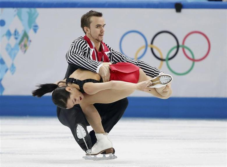 Ksenia Stolbova (bottom) and Fedor Klimov of Russia compete during the figure skating team pairs free skating at the Sochi 2014 Winter Olympics, February 8, 2014. REUTERS/Lucy Nicholson