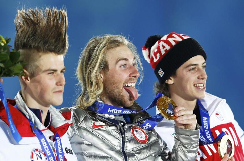 Gold medalist Sage Kotsenburg of the U.S., silver medalist Staale Sandbech (L) of Norway and bronze medalist Mark McMorris (R) of Canada react during the medal ceremony for the men's snowboard slopestyle competition in the Olympic Plaza at the 2014 Sochi Olympic Games February 8, 2014. REUTERS/Shamil Zhumatov