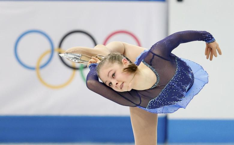 Yulia Lipnitskaya of Russia competes during the figure skating team ladies short program at the Sochi 2014 Winter Olympics, February 8, 2014. REUTERS/Lucy Nicholson