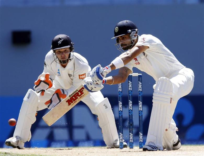 India's Virat Kohli plays a shot watched by New Zealand's BJ Watling during his second innings on day four of the first international test cricket match at Eden Park in Auckland, February 9, 2014. REUTERS/Nigel Marple
