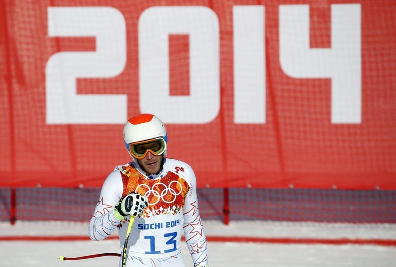 Bode Miller of the U.S. skis during the third training session for the men's alpine skiing downhill event at the 2014 Sochi Winter Olympics at Rosa Khutor Alpine Center February 8, 2014. REUTERS/Leonhard Foeger