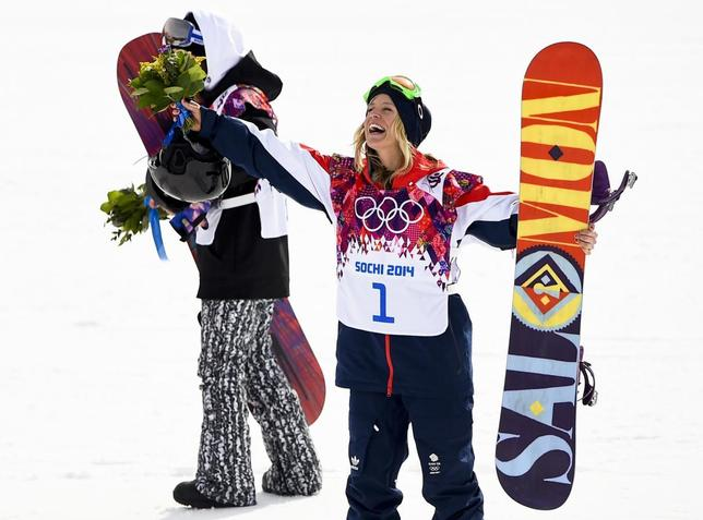 Third placed Britain's Jenny Jones gestures during flower ceremony after competing in the women's snowboard slopestyle finals event at the 2014 Sochi Winter Olympics in Rosa Khutor, February 9, 2014. REUTERS/Dylan Martinez
