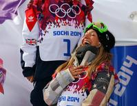 Jamie Anderson of the U.S. celebrates after winning the women's snowboard slopestyle competition at the 2014 Sochi Olympic Games in Rosa Khutor February 9, 2014. REUTERS/Mike Blake