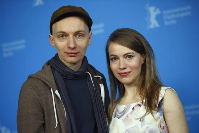 Director Dietrich Brueggemann (L) and screenwriter Anna Brueggemann pose during a photocall to promote the movie Kreuzweg (Station of the Cross) at the 64th Berlinale International Film Festival in Berlin February 9, 2014. REUTERS/Thomas Peter