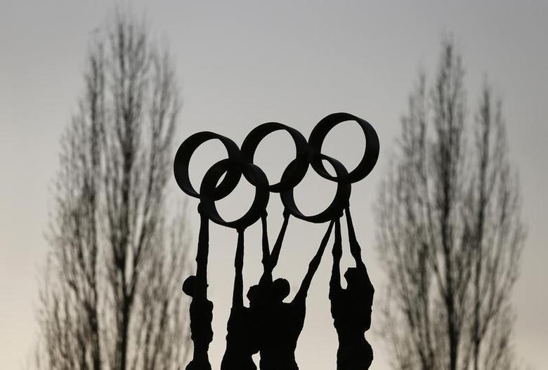 A statue is pictured in front of the International Olympic Committee (IOC) headquarters in Lausanne December 10, 2013. REUTERS/Denis Balibouse