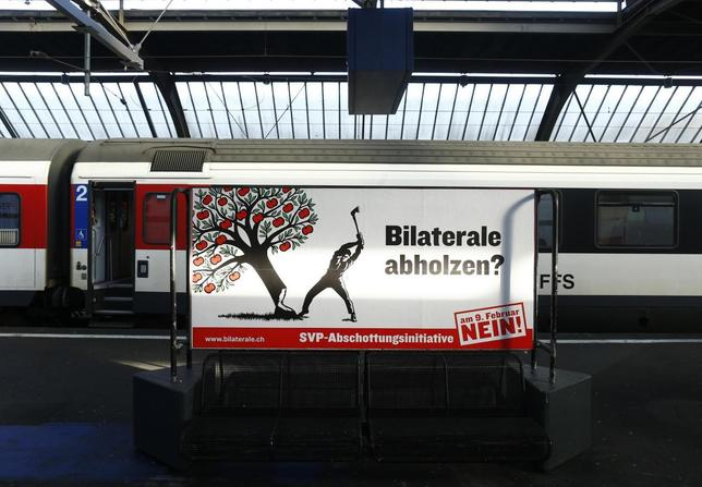 A poster against the ''mass immigration initiative'' of the Swiss People's Party SVP is seen at the main train station in Zurich February 1, 2014. REUTERS/Ruben Sprich