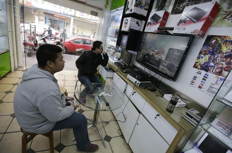 A man plays video game at a store selling video game consoles in Wuhan, Hubei province, January 9, 2014. REUTERS/Darley Shen