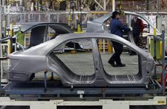 An Auto worker loads bodyshells of a Toyota Camry Hybrid car onto the assembly line at the Toyota plant in Melbourne August 31, 2009. REUTERS/Mick Tsikas