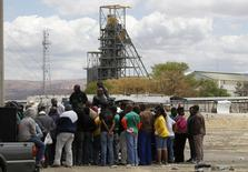 Miners gather near the Anglo American Platinum's Thembelani mine near the mining town of Rustenburg, northwest of Johannesburg September 30, 2013. REUTERS/Siphiwe Sibeko