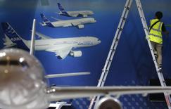 A worker makes final touches to the Airbus booth ahead of the Singapore Airshow February 10, 2014. REUTERS/Edgar Su