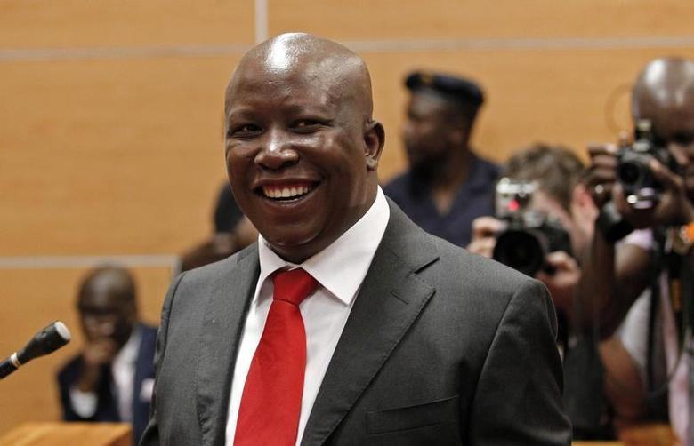 Julius Malema, expelled African National Congress (ANC) youth leader, and current leader of the Economic Freedom Fighters (EFF) political party, smiles at Polokwane High Court, where he appeared on charges of money laundering and racketeering, November 18, 2013. REUTERS/Siphiwe Sibeko