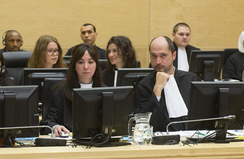 Defense Counsel Marc Desalliers (R) and Caroline Buteau look on during the case against Congolese militia leader Bosco Ntaganda at the International Criminal Court in The Hague, February 10, 2014. REUTERS/Toussaint Kluiters/United Photos/Pool