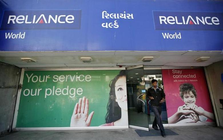 A customer leaves a Reliance communication store in Ahmedabad January 23, 2013. REUTERS/Amit Dave/Files