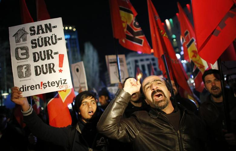 Protesters shout slogans, hold banners and wave flags as they demonstrate against new controls on the Internet approved by Turkish parliament this week in Ankara February 8, 2014. REUTERS/Umit Bektas