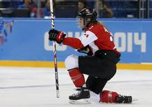 Canada's Meghan Agosta-Marciano celebrates her goal against Finland during the third period of their women's ice hockey game at the Sochi 2014 Sochi Winter Olympics, February 10, 2014. REUTERS/Jim Young