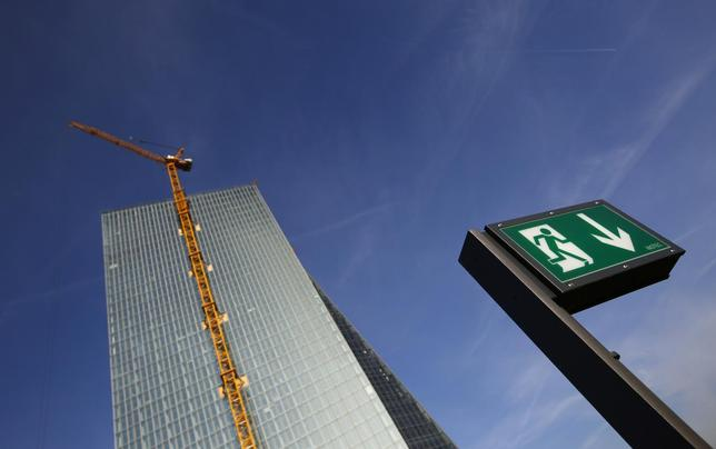 The emergency exit sign of a restaurant is seen next to the construction site of the new European Central Bank (ECB) headquarters in Frankfurt, December 3, 2013. REUTERS/Kai Pfaffenbach