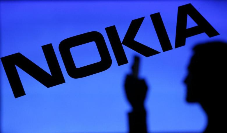 A photo illustration of a man silhouetted against a Nokia logo in the central Bosnian town of Zenica January 23, 2014. REUTERS/Dado Ruvic
