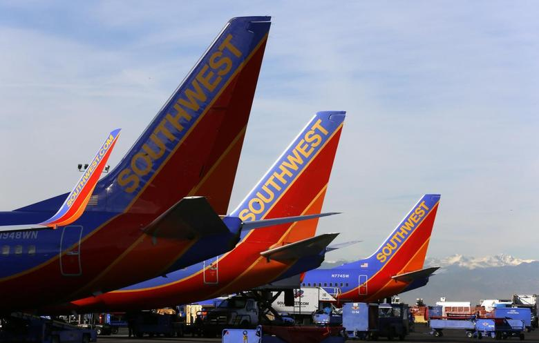 Southwest Airlines jets wait on the tarmac at Denver International Airport in Denver January 22, 2014. REUTERS/Rick Wilking