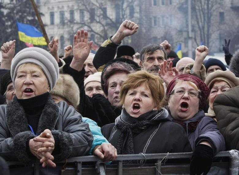People shout slogans during an anti-government rally in Kiev February 9, 2014 file photo. REUTERS/Gleb Garanich