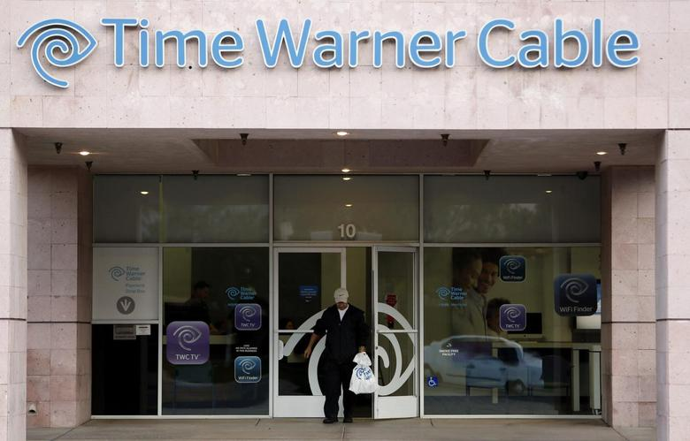 A customer leaves a Time Warner Cable store in Palm Springs, California January 29, 2014. REUTERS/Sam Mircovich