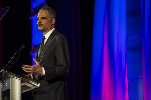 U.S. attorney general Holder says he will stay on well into 2014
