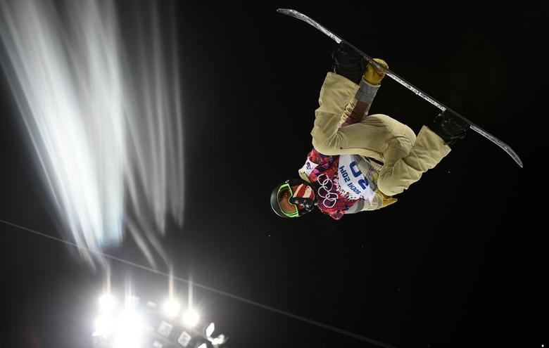 Shaun White of the U.S. performs a jump during a training session for the snowboard men's halfpipe competition at the 2014 Sochi Winter Olympic Games in Rosa Khutor February 10, 2014. REUTERS/Dylan Martinez