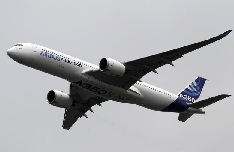 An Airbus A350 flies during an aerial display at the Singapore Airshow February 11, 2014. REUTERS/Edgar Su