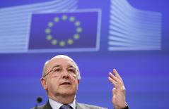 European Union Competition Commissioner Joaquin Almunia speaks during a news conference at the EU Commission headquarters in Brussels February 5, 2014. REUTERS/Francois Lenoir