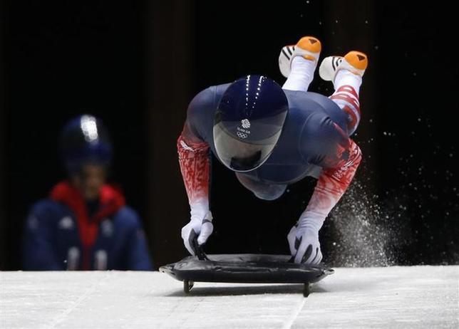Britain's Kristan Bromley starts an unofficial men's skeleton progressive training at the Sanki sliding center in Rosa Khutor, a venue for the Sochi 2014 Winter Olympics near Sochi, February 5, 2014. REUTERS/Murad Sezer