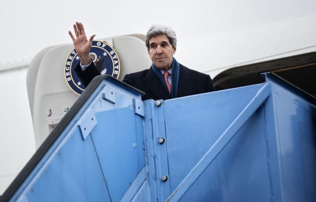 U.S. Secretary of State John Kerry waves while boarding his plane at Franz-Josef-Strauss Airport in Munich, southern Germany, February 2, 2014. REUTERS/Brendan Smialowski/Pool