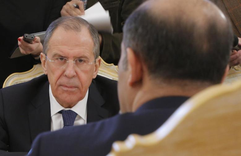 Russia's Foreign Minister Sergei Lavrov listens during a meeting with Syrian opposition leader Ahmad Jarba in Moscow February 4, 2014. REUTERS/Maxim Shemetov