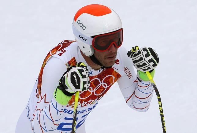 Bode Miller of the U.S. reacts after the downhill run of the men's alpine skiing super combined training session at the 2014 Sochi Winter Olympics at the Rosa Khutor Alpine Center February 11, 2014. REUTERS/Leonhard Foeger