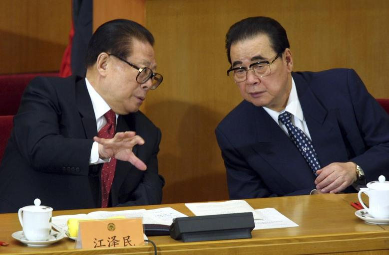 China's President Jiang Zemin (L) talks with top lawmaker Li Peng, Chairman of the National People's Congress, during the opening ceremony of the Chinese People's Political Consultative Conference (CPPCC) at the Great Hall of the People in Beijing, in this March 3, 2002 file picture. REUTERS/Andrew Wong/Files