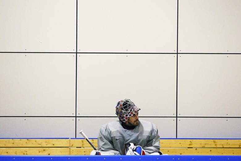 The U.S. men's hockey team goaltender Ryan Miller sits on the bench during a team USA practice at the 2014 Sochi Winter Olympics February 11, 2014. REUTERS/Brian Snyder