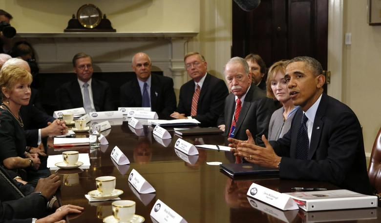 U.S. President Barack Obama meets with health insurance chief executives at the White House in Washington November 15, 2013 file photo. REUTERS/Kevin Lamarque