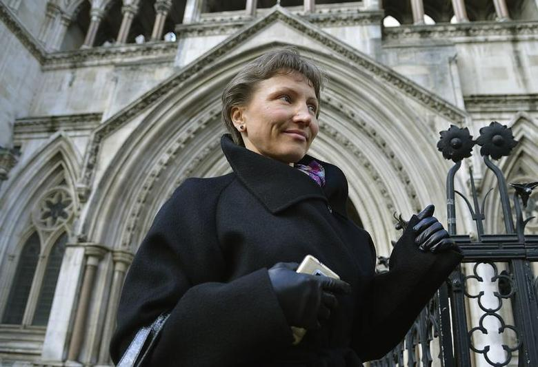 Marina Litvinenko, the wife of former KGB agent Alexander Litvinenko, who was murdered in London in 2006, leaves the High Court in London March 14, 2013. REUTERS/Toby Melville