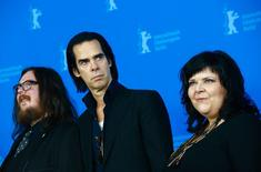 """Directors Ian Forsyth (L) and Jane Pollard (R) pose with cast member Nick Cave during a photocall promoting the movie """"20,000 Days on Earth"""" at the 64th Berlinale International Film Festival in Berlin February 10, 2014. REUTERS/Thomas Peter"""
