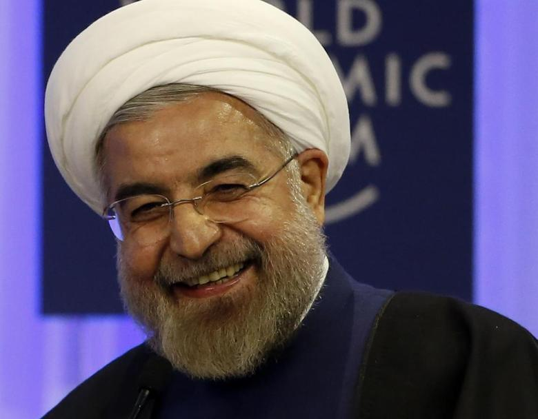 Iran's President Hassan Rouhani smiles during a session at the annual meeting of the World Economic Forum (WEF) in Davos January 23, 2014. REUTERS/Ruben Sprich