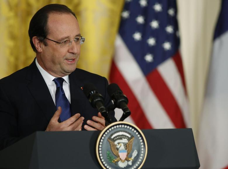 French President Francois Hollande addresses a joint news conference with U.S. President Barack Obama in the East Room of the White House in Washington, February 11, 2014. REUTERS/Gary Cameron