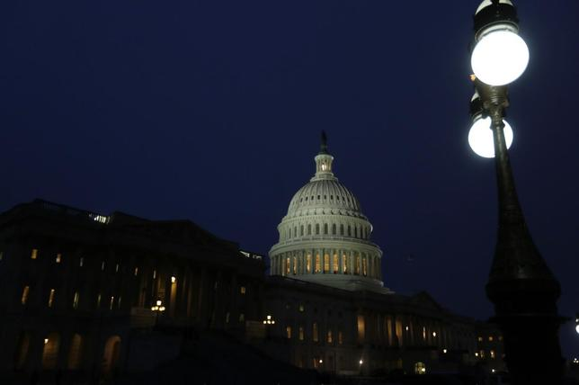 The Capitol building is seen before U.S. President Barack Obama delivers his State of the Union address in front of the U.S. Congress, on Capitol Hill in Washington January 28, 2014. REUTERS/Gary Cameron