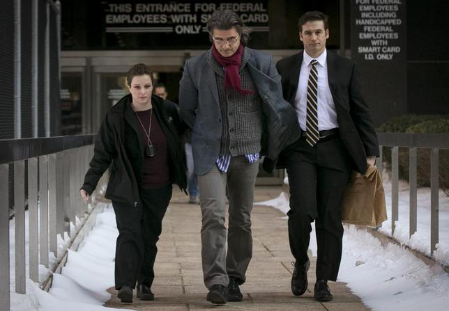 A suspect is escorted by FBI agents from their Manhattan offices in New York February 11, 2014 file picture. REUTERS/Brendan McDermid