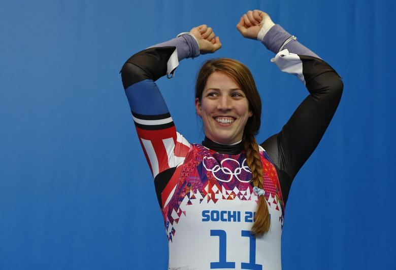 Third-placed Erin Hamlin of the U.S. celebrates after the women's singles luge event at the 2014 Sochi Winter Olympics, at the Sanki Sliding Center in Rosa Khutor February 11, 2014. REUTERS/Arnd Wiegmann