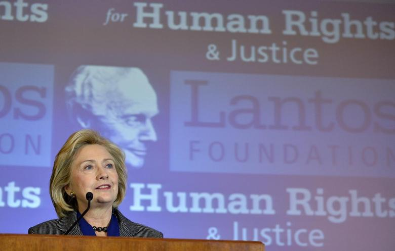 Former U.S. Secretary of State Hillary Clinton makes remarks after receiving the 2013 Tom Lantos Human Rights Prize from the Lantos Foundation for Human Rights and Justice, during a ceremony on Capitol Hill in Washington, December 6, 2013 file photo. REUTERS/Mike Theiler