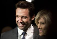 Actor Hugh Jackman (L) and wife Deborra-Lee Furness arrive for the Donna Karan New York show during New York Fashion Week February 10, 2014. REUTERS/Carlo Allegri