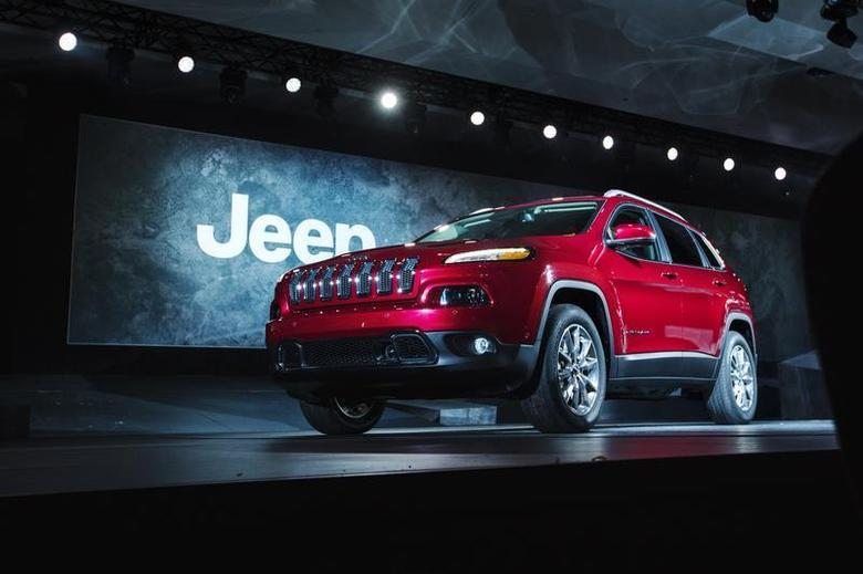 A 2014 Jeep Cherokee is seen on stage after being unveiled at the New York International Auto Show in New York, March 27, 2013. REUTERS/Lucas Jackson