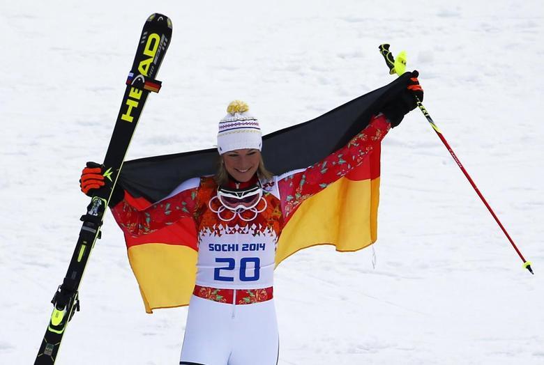 Germany's Maria Hoefl-Riesch celebrates winning the women's alpine skiing super combined event at the 2014 Sochi Winter Olympics at the Rosa Khutor Alpine Center February 10, 2014. REUTERS/Dominic Ebenbichler