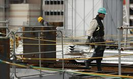 Men work at a construction site in Tokyo February 12, 2014. REUTERS/Yuya Shino
